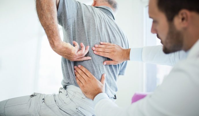 what causes back pain and treatment